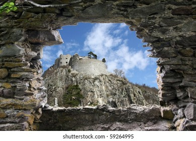 A ruins fort is seen from another ruins
