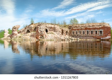 Ruins of fortification ferlecting in water of flooded moat of Daugavpils fortress. Daugavpils, Latvia