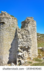 ruins of a fortress on a hill, an ancient building