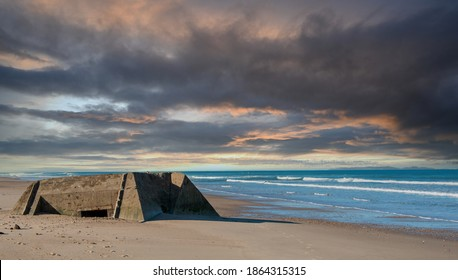 ruins of a german bunker in the beach of Normandy, France