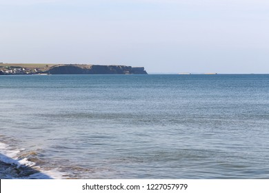 Ruins of harbor built by the Allies in Arromanches, Normandy, France