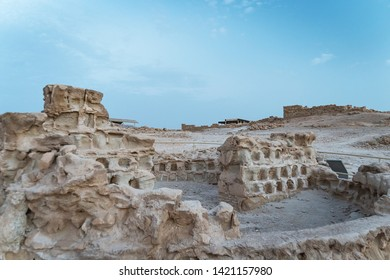 Ruins of Herods castle in fortress Masada, Israel. Ancient ruins of fortification built on the plateau on the mountain overlooking the Dead Sea. Famous Masada. Remains of old stone constructions