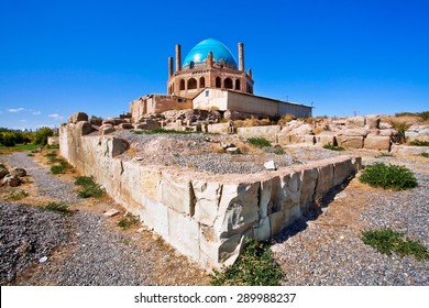 Ruins of historical wall around 14th century mausoleum Dome of Soltaniyeh near Zanjan city, Iran. UNESCO World Heritage Site, anticipating the Taj Mahal, erected from 1302 to 1312 AD.