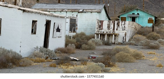 Ruins of a industrial town. One nice white picket fence still trying to do its job.