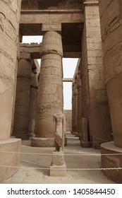 Ruins of Karnak Temple in Luxor, Egypt. The temple complex at Karnak includes many ancient chapels, temples, monuments, columns with hieroglyphs and statues of the ancient Egyptian civilization