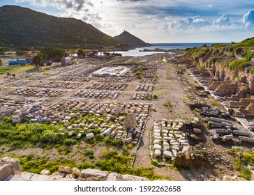 Ruins of Knidos ancient city on Datca peninsula in Turkey with old stones in rows and bright back light