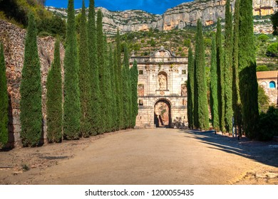 Ruins of La Cartoixa de Santa Maria d'Escaladei (Carthusian Monastery of Santa Maria d'Escaladei) in Priorat, Catalonia, Spain on a bright, sunny day.