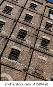 Ruins of a large industrial brick building with broken windows etc. Great background / texture