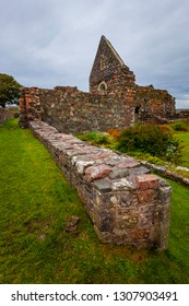 Ruins of low wall at the nunnery on the island of Iona