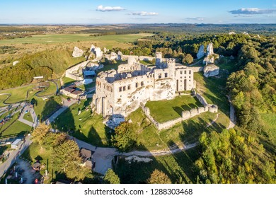 The ruins of medieval castle on the rock in Ogrodzieniec, Poland. One of strongholds  called Eagles Nests in Polish Jurassic Highland in Silesia. Aerial view at sunset