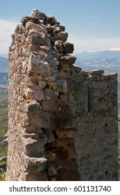 The ruins of medieval fortress of Acrocorinth up on the hill, the inner part is surrounded by old walls, on a bright sunny day, Peloponnese, Greece