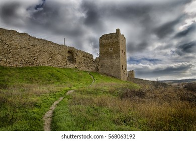 the ruins of a medieval tower and walls
