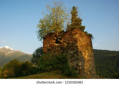 ruins of a medieval watchtower on the background of Mount Tetnuldi. Svaneti, Georgia