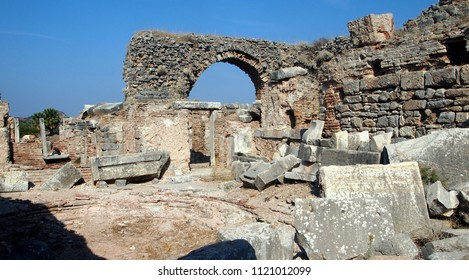 Ruins (mere remnants) of the ancient city of Ephesus, once second to only Rome. Stone walls, arches and parts of columns visible. Taken near Agora at the Ephesus archeological site (Turkey).