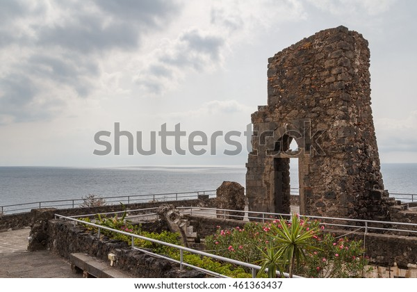 Ruins of the Norman castle in Aci Castello, Sicily island, Italy