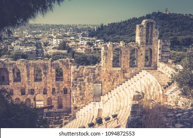 Ruins of the Odeon of Herodes Atticus at the Acropolis of Athens, Greece. This ancient Greek theatre is one of the main landmark of Athens. Scenic view of Odeon overlooking Athens city in summer.