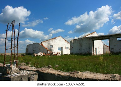 The ruins of old farms without a roof in Ukraine on a sunny summer day