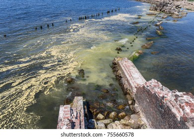 Ruins of the old fortification in the Baltic sea water.