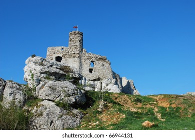 The ruins of the old fortified castle. The walls and tower built of white limestone.