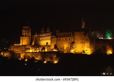 The ruins of the old Heidelberg castle illuminated at night