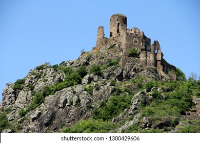 ruins of an old medieval fortress on the top of a mountain in France