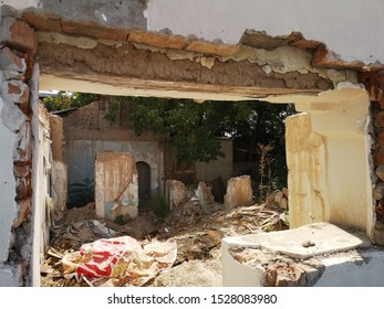 The ruins of an old poor little house. The house of clay and brick is destroyed. A rural house is falling apart from old age.