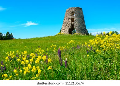 Ruins of old windmill tower on a field. Estonia, Baltic States, Europe
