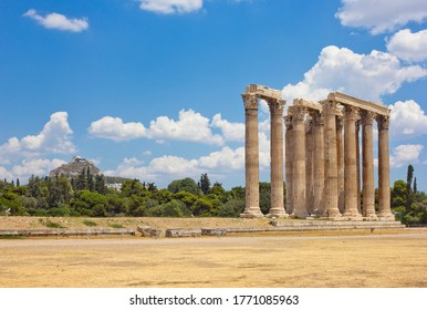 Ruins of Olympieion (the Temple of Olympian Zeus) with Acropolis on the background in Athens, Greece