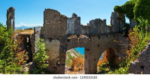 The ruins of the original settlement of Maratea on a rocky escarpment just below the Christ the Redeemer statue on San Biagio mountain, Tyrrhenian sea coast, Basilicata, Italy.