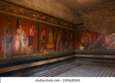 Ruins of Pompeii, Italy. Decoration detail. Fresco painting on the wall of Villa of the Mysteries.