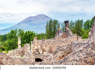 Ruins of Pompeii overlooking Mount Vesuvius in the distance, Campania, Italy. Pompeii is an ancient Roman city died from the eruption of volcano Vesuvius in 79 AD. Scenic view of Vesuvius near Naples.