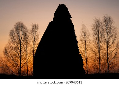 ruins in the red light of the setting sun
