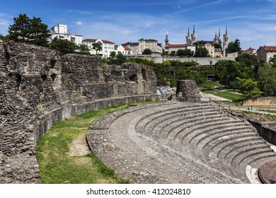 Ruins of Roman Theatre in Lyon. Basilica of Notre-Dame de Fourviere in the background. Lyon, Rhone-Alpes, France.