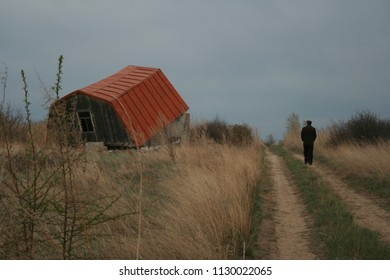 The ruins of a rural house, the silhouette of a departing person, the concept of loneliness, loss, despair.