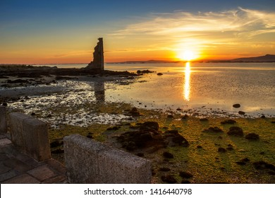 Ruins of Saint Sadurnino tower in Cambados town at golden sunset background in Arousa estuary