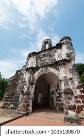 Ruins of the Santiago Fort in Malacca, Malaysia. Low angle view of the old architecture against blue sky.