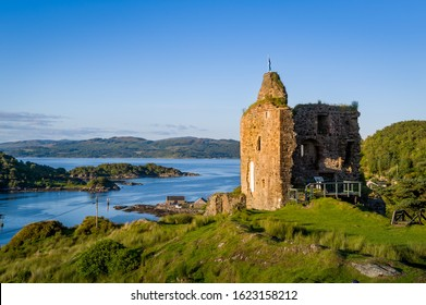 Ruins of Tarbert Royal Castle. Sunset light and panoramic view of the bay. Inner Henrides, Scotland.