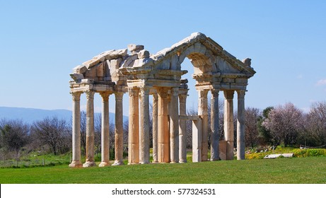 ruins of a Temple of Aphrodite on a green grass field under a blue sky in the Mediterranean region - Shutterstock ID 577324531