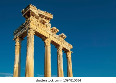 The ruins of the Temple of Apollo in ancient sity of Side in Turkey against the blue sky clouse-up