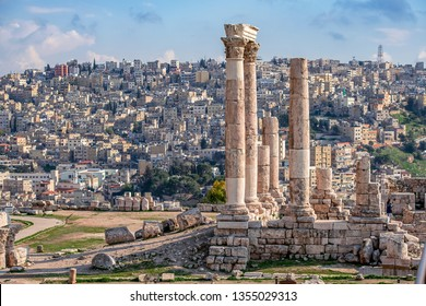 Ruins of the Temple of Hercules on the top of the mountain of the Amman citadel with a view of the ancient Middle Eastern city