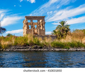 The ruins of the Temple of Isis in a blur foreground, Aswan, Egypt
