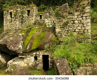 The ruins of the Temple of the Moon at the bottom of Wayna Picchu, built by the ancient Inca. Machu Picchu, Peru, South America.