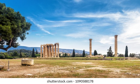 Ruins of Temple of Olympian Zeus in Athens, Greece. The ancient Greek Temple of Zeus or Olympieion is one of the main landmarks of Athens. Panoramic view of Columns of the Olympian Zeus in summer.