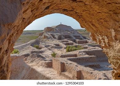 Ruins of the Toprak Kala fortress through arch in Khorezm, Uzbekistan
