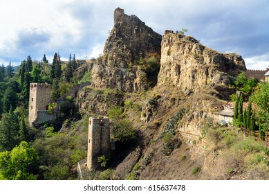 Ruins and towers of Narikala Fortress on hill in Tbilisi, Georgia