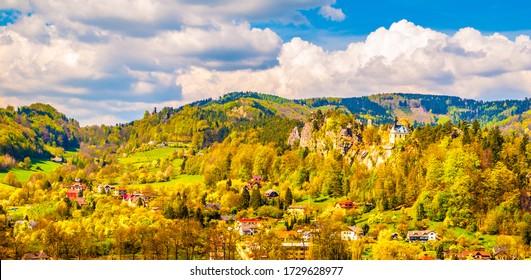 Ruins of Vranov Castle with small rock chapel, aka Pantheon, in Mala Skala on sunny summer day with blue sky and lush green trees, Bohemian Paradise, aka Cesky Raj, Czech Republic. - Shutterstock ID 1729628977