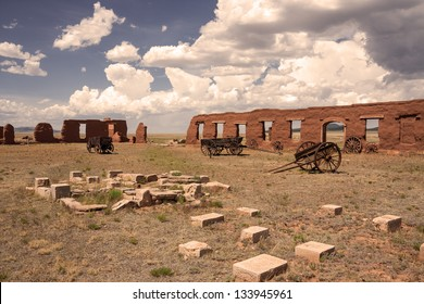 Ruins and wagons at Fort Union in sepia tone
