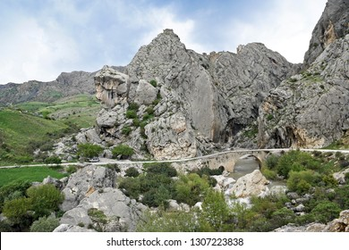 Ruins of Yeni Kale (New Fortress) on rocky hill above river with arched stone bridge, Mount Nemrut, Eastern Anatolia, Turkey