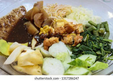 Rujak cingur. Indonesian food with various types of vegetables and beef.