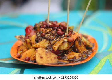 Rujak Medan as known as fruit salad with spicy dressing and ground bean as well